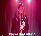 Concert Image of Douglas Blue Feather Playing Flute on Stage